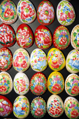 Hand Crafted Wooden Easter Eggs On Black Background
