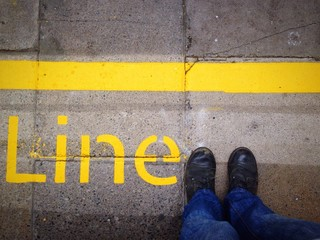 standing on the yellow line