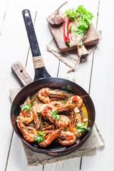 Fried king prawns served on hot pan