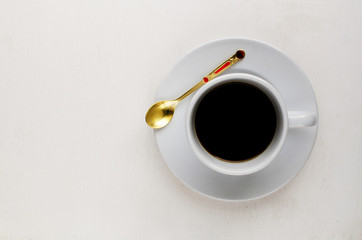 White cup coffee on wood background
