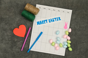 Easter bunny symbol on calendar with eggs and decorations