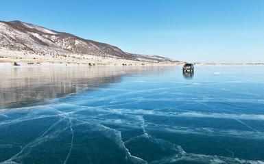 Baikal Lake. Winter travel on ice by car