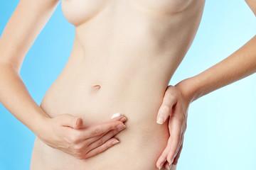 Woman applying moisturizer cream to her skin