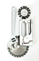 Metalwork. Saw, spanner and others tools on white background.