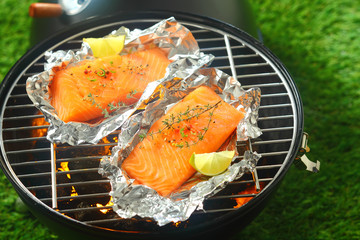 Salmon fillets grilling on an open fire