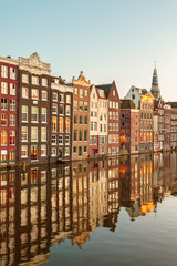 Ancient canal houses in the Dutch capital city Amsterdam