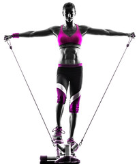 Fototapete - woman fitness stepper resistance bands exercises
