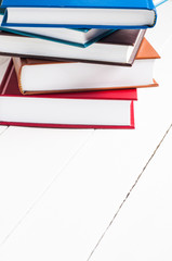 stack of books lying on white table