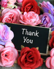 thank you sign on chalkboard, with flowers