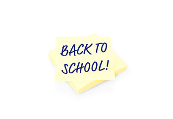 Yellow sticky note on block with text Back To School
