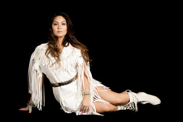 Native American woman in white outfit sit on black look straight