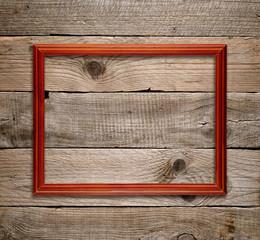 Wooden frame on old wooden background