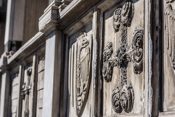Decorative cross - architectural detail on facade of basilica