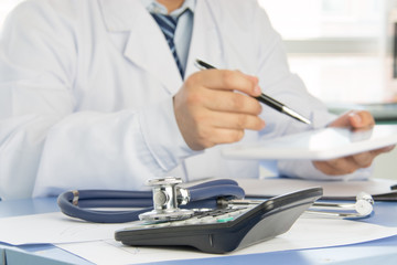 Close-up of stethoscope on background of doctors at work