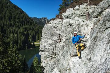 Österreich, Salzburger Land, Altenmarkt-Zauchensee, Mann am Klettersteig