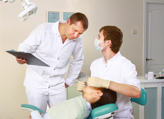 Young woman with dentist in a dental surgery. Healthcare
