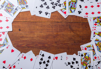 Playing cards arranged in a frame for background