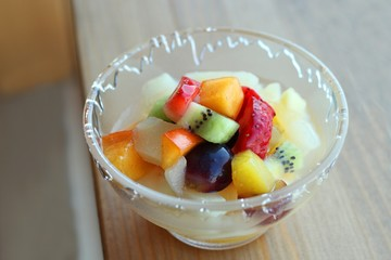 Glass bowl of fresh pieces of fruit or salad