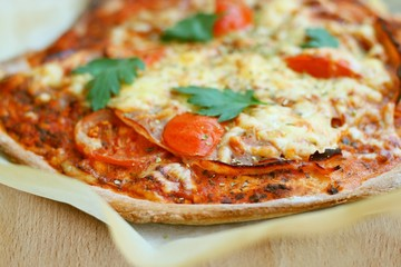 Home made spelt pizza with fresh tomatoes, cheese
