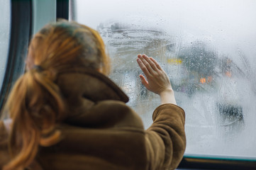 Woman wiping dew off window