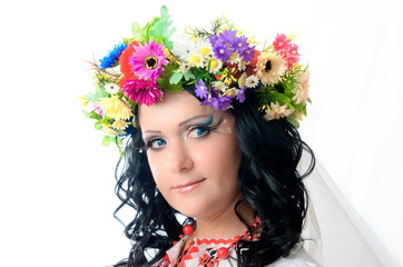 Ukrainian girl with colorful corolla on the head