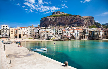 Beautiful old harbor with wooden fishing boat in Cefalu, Sicily