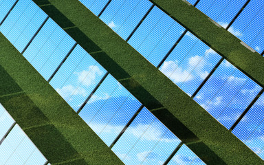 Top View of Modern Solar Panels Farm on beautiful Green Grass