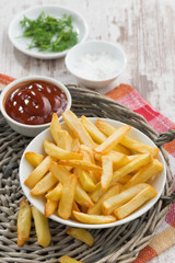 fried french fries with tomato sauce, vertical