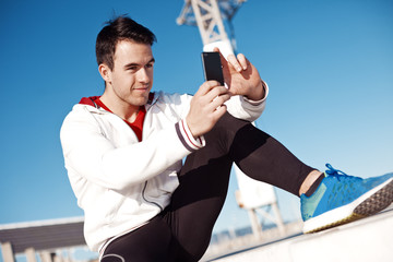 handsome athlete taking photo after training outdoors