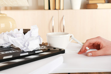 Female hand with cigarette at desktop with moving clapper and