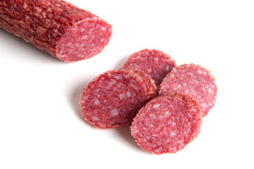 Sliced sausage on a white background