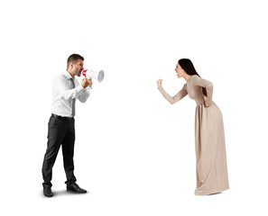 woman showing her fist to screaming man