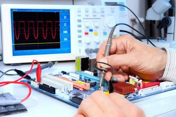 Tech tests electronic equipment