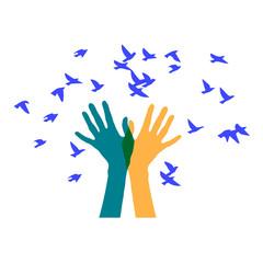 hands releasing a flock of birds