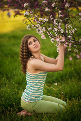 Young girl beauty portrait in the garden
