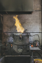 Flame coming out of a cupola furnace in a foundry