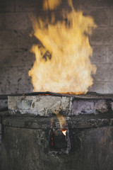 Closeup of flame coming out of furnace in a foundry