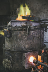 Cupola furnace melting down bronze for casting