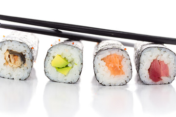 Sushi maki with chopsticks isolated on white background