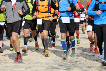 runners run during the competitive race in sporting event