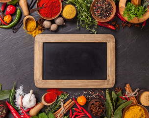 Wall Mural - Various spices on stone with blackboard