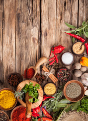 Wall Mural - Various spices on wood