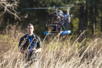 man flying uav helicopter