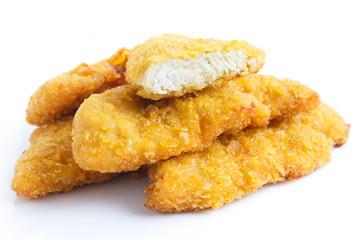 Golden fried chicken strips on white.