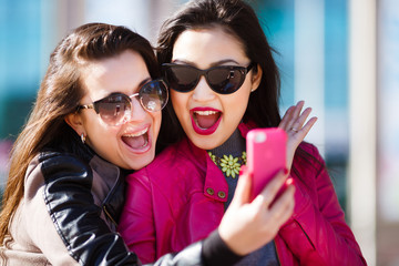 Two happy women making selfie photo