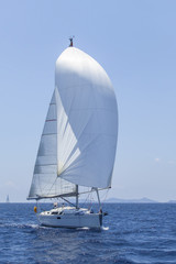 Ship yachts with white sails in the open Sea. Luxury Lifestyle.