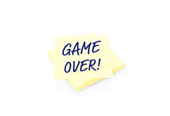 Yellow sticky note on block with text Game Over
