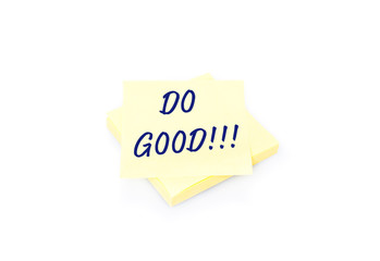 Yellow sticky note on block with text Do Good