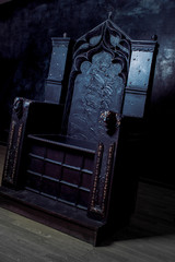 Royal throne. dark Gothic throne, side view