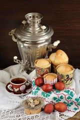 Kulichi, traditional Russian easter cakes with samovar, black te